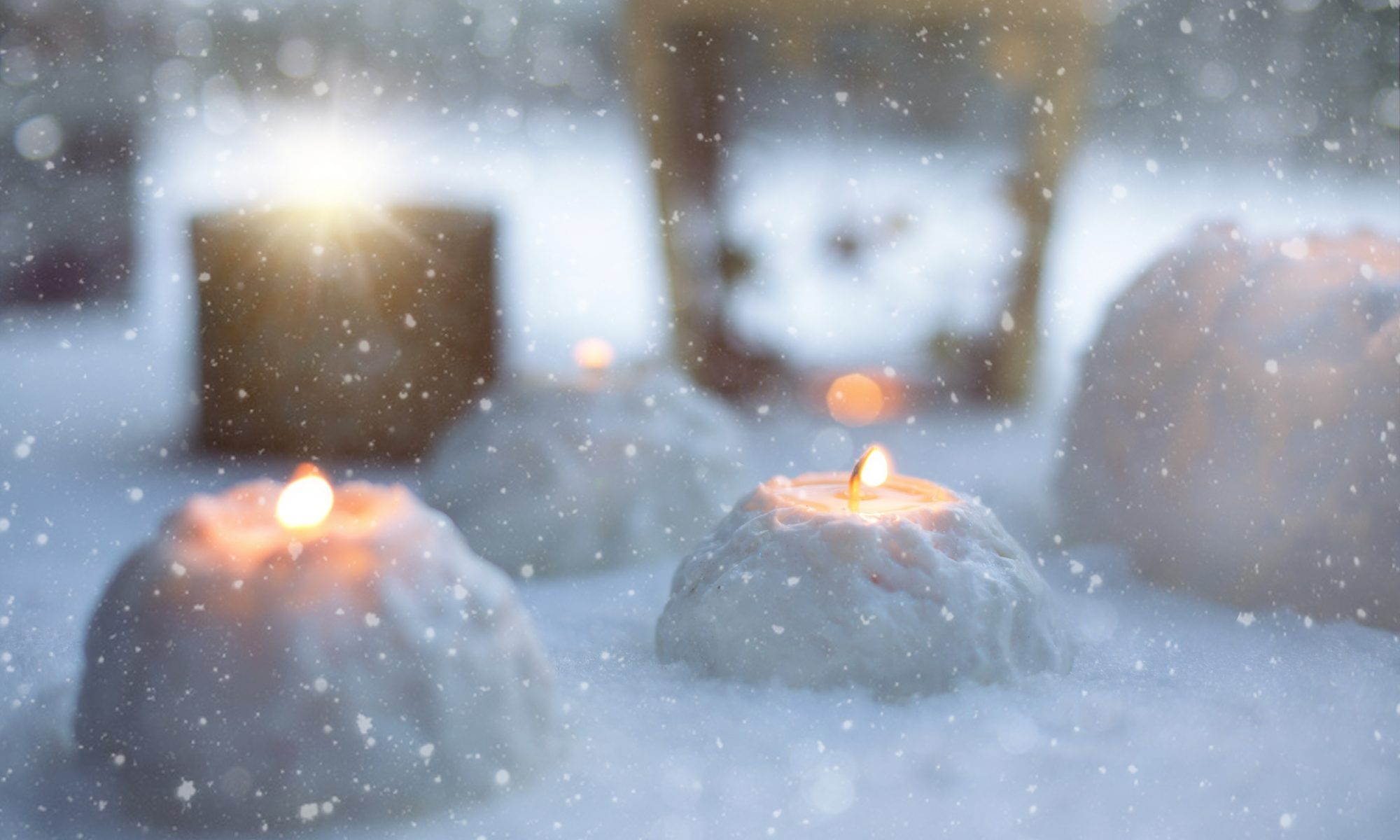 blurry photo of round candles in snow