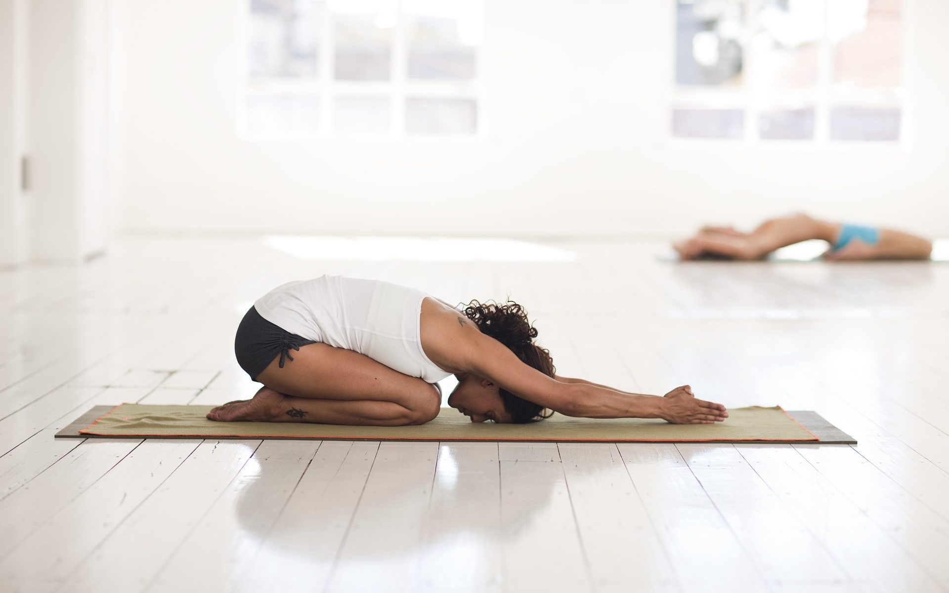 female in childs pose yoga in meditation